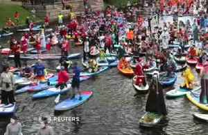 Paddleboard masquerade brings colors to St. Petersburg canals [Video]