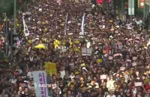 Tens of thousand march for democratic reform in Hong Kong amid political tensions [Video]