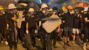 News video: Hong Kong protesters create noise before a police push forces crowds back