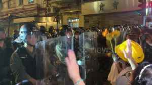 Protesters attempt to give flowers to riot police before attempt to clear streets [Video]