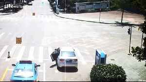 Heroic taxi driver chases down driverless car rolling down road in China and stops it [Video]