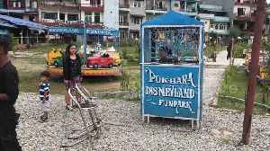 A knockoff 'Disneyland' amusement park in Nepal is full of rusty rides [Video]