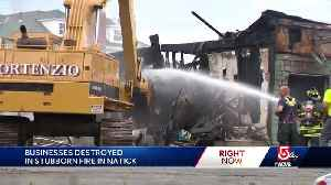 Businesses destroyed when 120-year-old building burns [Video]