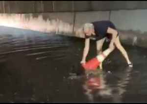 Woman Helps to Clear Clogged Drains During Flash Flooding in Brooklyn [Video]
