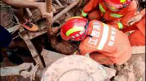 Chinese firefighters rescue worker trapped in a concrete pipe after falling down well [Video]