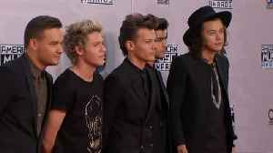 Louis Tomlinson upset by One Direction split story [Video]