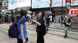 Standoff between police and protesters in Hong Kong's Yuen Long district [Video]