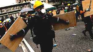 Defying police ban, HK protesters return to gang-attack scene [Video]