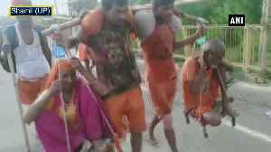 Four sons carry their parents on shoulder for Kanwar Yatra [Video]
