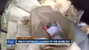Teens distribute lunches to the homeless in Milwaukee's 'Tent City' [Video]