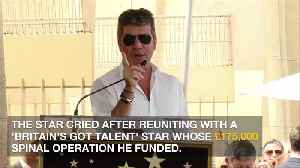 Simon Cowell sobbed after reuniting with Britain's Got Talent's star [Video]
