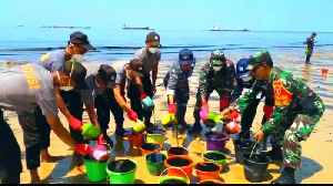 Oil spill spoils Indonesian beaches, major cleanup operation on [Video]