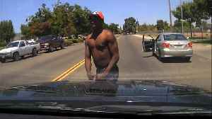 News video: Car thief wisely changes his mind about attacking police officer