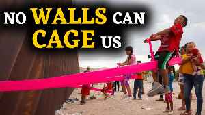 See-saw installed at US-Mexico border wall lets children play [Video]