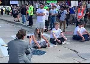 Protesters Block Detroit-Windsor Tunnel Entrance Prior to Democratic Debate [Video]