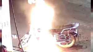 Alleged drunk man sets his own motorbike on fire at petrol station in China [Video]