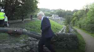 Prime Minister Boris Johnson visits flood hit dam [Video]