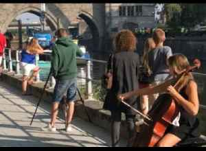 'I Wanted to Protest One Last Time': Belgian Cellist Performs by Medieval Bridge Slated for Reconstruction [Video]