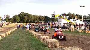 'Ready, steady, mow!' Bizarre 12-hour lawn mower race held in English country village [Video]