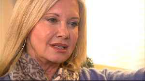 Olivia Newton-John is 'living with cancer very well' [Video]