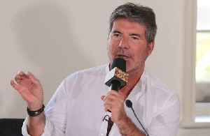 Simon Cowell in line to win an OBE? [Video]