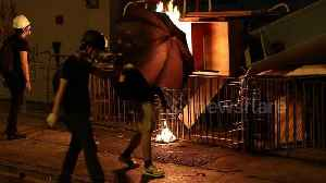 News video: Hong Kong protestors start fire at police station as fire department rushes to extinguish it