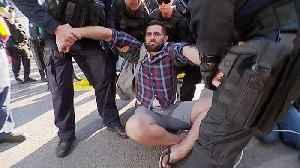 Extinction Rebellion protesters arrested after blocking lanes in Brisbane [Video]
