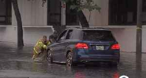 Heavy rain causes drivers to become stuck on flooded streets in West Palm Beach [Video]
