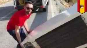 Man dumps fridge in ravine, cops make him haul it back up [Video]