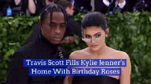 Travis Scott Literally Covers Kylie Jenner's Home In Flowers [Video]