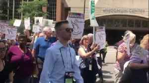 Hundreds protest President Trump's immigration policies in downtown Milwaukee Wednesday [Video]