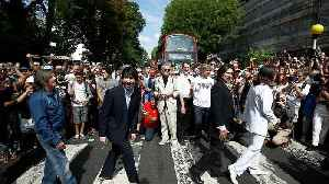 Fans recreate Beatles' iconic Abbey Road cover shot 50 years on [Video]