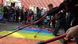 Residents paint street in colours of rainbow flag to celebrate Reykjavik Pride [Video]