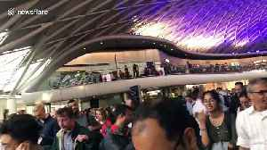 During a London power outage hundreds of commuters pile out of Kings Cross station [Video]