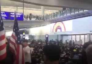 Protesters Crowd Arrivals Hall at Hong Kong Airport [Video]