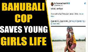 Gujarat Floods: Policeman saves two girls on his shoulders in gushing waters, video viral | Oneindia [Video]