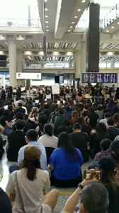 News video: Protesters Sing as They Stage Another Sit-In at Hong Kong Airport