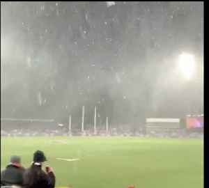 'This is Fun Isn't It?': Snow Falls During Hawthorn Versus GWS Giants Match in Canberra [Video]
