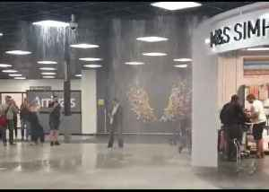 Water Pours Through Ceiling into Luton Airport [Video]