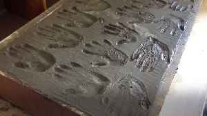 Harland and Wolff 'auld hands' leave palm prints in concrete [Video]