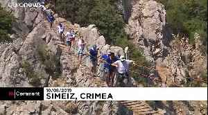Divers compete in jumping off 27-metre cliff platform in Crimea [Video]