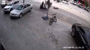 Chinese boy almost gets run over after riding segway on a road [Video]