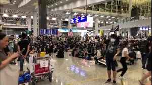 Protesters occupy Hong Kong International Airport cancelling all departure flights [Video]