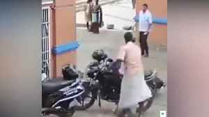Biker front flips and lands head first into wall [Video]