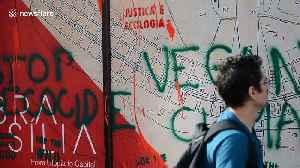 Extinction Rebellion activist glues himself to Brazilian embassy in London [Video]