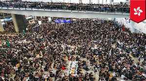 News video: Hong Kong airport cancels flights as thousands peacefully protest
