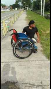 Heartwarming moment disabled man climbs out of wheelchair to save kitten stuck in drain in Malaysia [Video]