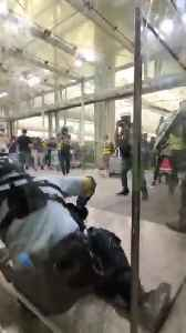 Police and protesters clash at Hong Kong Airport [Video]
