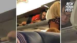 News video: Flight attendant weirds out passengers by hiding in overhead bin
