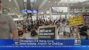 News video: Hong Kong Pro-Democracy Protesters Disrupt Airport For 2nd Day